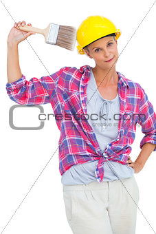 Beautiful handy woman holding a brush and smiling at camera