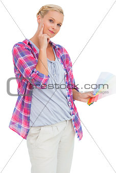 Blonde holding color charts and picking colour