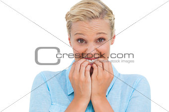 Stressed attractive young woman looking at camera