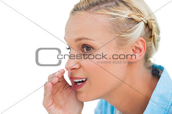 Close up of a blonde speaking to someone and looking at something