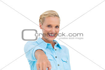 Blonde woman pointing with finger