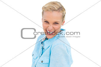 Blonde woman laughing at camera