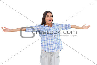Young woman standing with her arms open