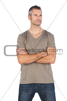 Thoughtful man with arms crossed
