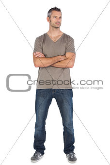 A man standing with arms crossed