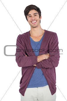 Cheerful young man with arms crossed