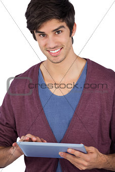 Smiling young man using tablet pc