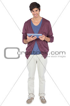 Smiling man with tablet pc