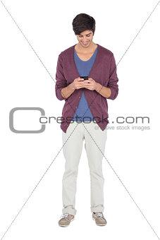 Smiling man looking at his mobile phone