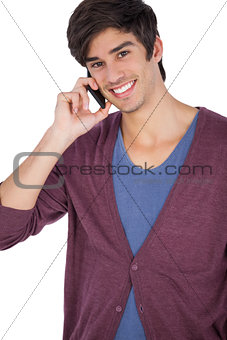 Smiling young man with mobile phone