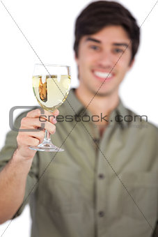 Man holding white wine glass