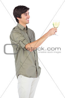 Happy young man with wine glass