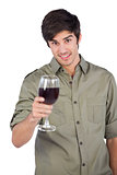 Smiling man holding red wine glass
