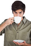 Man drinking cup of coffee