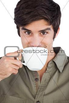 Portrait of man drinking coffee