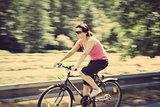 pretty woman riding a bicycle