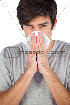 Portrait of man blowing his nose