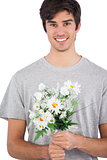 Young man holding flower bouquet
