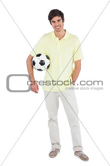 Smiling man holding soccer ball