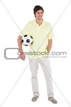 Happy man holding soccer ball