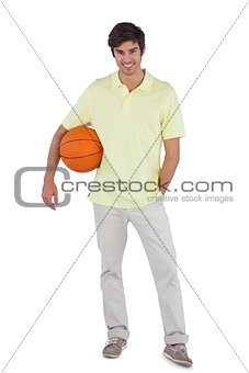 Young man holding basket ball