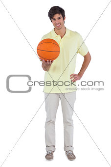 Smiling man holding a basket ball