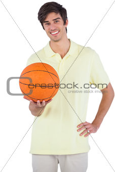 Happy man holding a basket ball