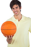 Portrait of a smiling man holding basket ball