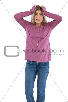 Anxious woman with hands on head