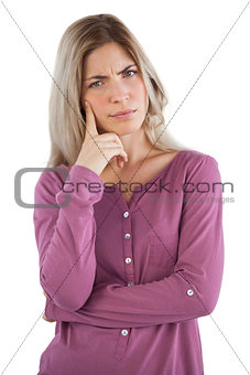 Troubled woman with hand on chin