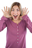 Surprised young woman raising hands