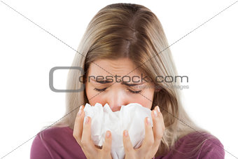 Sick woman with handkerchief on her hands