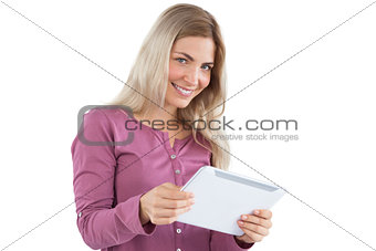 Blonde woman holding tablet pc