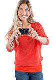 Blonde woman taking picture