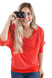 Blonde woman holding digital camera