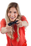 Young woman having fun with video games