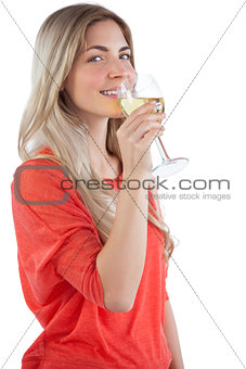 Smiling young woman with wine glass