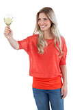 Woman looking at white wine glass