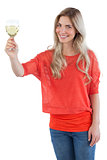 Smiling woman holding white wine glass