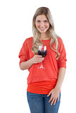 Blonde woman holding a wine glass