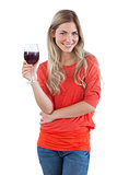 Smiling woman looking at the camera with red wine glass