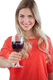 Woman holding red wine glass