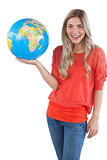Cheerful woman holding globe