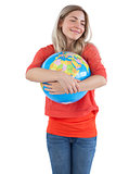 Woman embracing a globe
