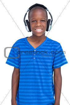 Smiling boy listening to music