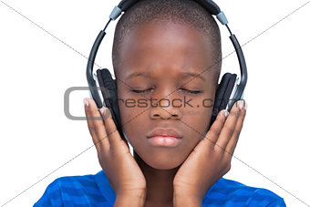 Little boy enjoying music