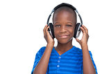 Smiling little boy listening to music