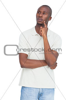 Thoughtful man with hand on chin