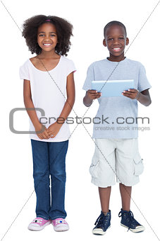 Smiling boy holding tablet pc