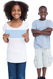 Smiling girl holding tablet pc with her brother